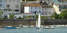 Europe / United Kingdom / Salcombe ->     We are a   16th century fisherman's cottage right on the waterfront with gorgeous views    Where   In the heart of Salcombe, one of the most exclusive resorts in England, at the southernmost tip of Devon    Why stay   Spinnaker Cottage is a cosy property with space for 6 guests. The town centre location combined with lovely views and access to a private slipway makes it ideal for keen sailors   www.SwapNights.com
