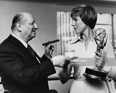 British showbusiness impresario Sir Lew Grade (1906 - 1998) hands a cup of tea to actress and singer Julie Andrews at ATV House, London, 6th June 1973. Andrews is holding the Emmy Award she recently won in Hollywood for 'The Julie Andrews Hour'.