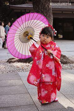Kawaii Japanese girl in kimono with umbrella