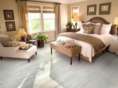 There is no reason at all that a small bedroom – even a really tiny bedroom – can't be every bit as gorgeous, relaxing, and just plain full of personality as a much larger space. Home Decor Bedroom, Bedroom Furniture, Bedroom Ideas, Small Master Bedroom, Luxury Vinyl Tile, Vinyl Sheets, Cool Beds, Vinyl Flooring, Plank Flooring