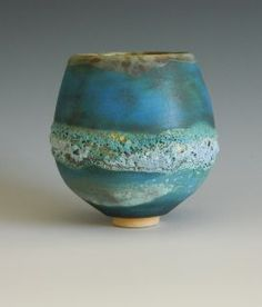 Jan Lewin-Cadogan. Technical: white stoneware clay. Various barium glazes. Various lava/crater glazes. Glossy deep blue or turquoise stone ware glazes. Fired to 1260 Celsius.: