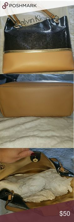 New Calvin Klein purse/tote New Calvin Klein purse/tote. Kept in dust bag, never used. Calvin Klein Bags