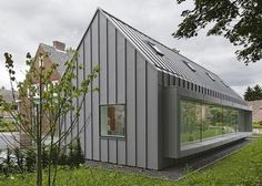 """Example of grey standing seam metal cladding for siding. With less """"modern"""" roofline this could be a possible alternative to the board and batten application. Dentist with a View by Shift Zinc Cladding, House Cladding, Metal Facade, Metal Siding, Zinc Roof, Modern Barn House, Suburban House, House Extensions, Historic Homes"""