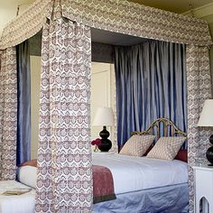 A canopy gives a bedroom instant coziness. The vintage rattan headboard dresses down all the silk and fabric.