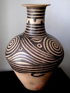 Ancient Chinese Neolithic Pottery painted with brown swirl and dots motif, Neolithic period ca. 3500 BC.: