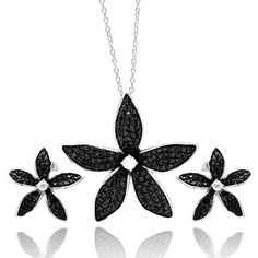 Show off your unique style and allurewhen you arrive inthis artfully inspired Cubic Zirconia andSterling Silver Flower Pendant & Earring Set. Impress you