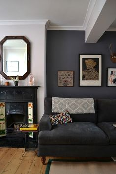 Name: Sue Huey & Graeme Fraser Location: Brighton, East Sussex, UK Years lived in: 4 years; Owned Located in the very heart of central Brighton, Sue and Graeme's Victorian townhouse is a refuge of tranquility, just yards from the city's main shopping stre Living Room Grey, Home And Living, Blue Feature Wall Living Room, Charcoal Sofa Living Room, Dark Grey Feature Wall, Living Room Accent Wall, Colour Schemes For Living Room, Navy Blue And Grey Living Room, Painted Feature Wall
