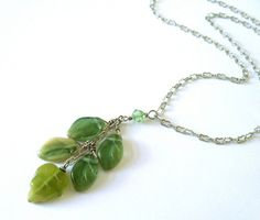 Green leaf drop necklace. Spring green leaf beads on antiqued silver chain. Glass leaf dangle necklace. Nature theme Spring jewelry. on Etsy, $30.00