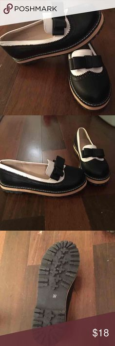 Black and white loafers never worn Loved these shoes when I ordered them but they have been sitting in my closet yet to be worn. I need the money more so I'm selling them.  I also have the matching purse listed. Shoes Flats & Loafers