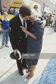 A sailor embraces his wife on the quayside after the Royal Navy's aircraft carrier H.M.S. Invincible returns to Portsmouth harbour, carrying Prince Andrew and other service personnel following the Falklands war, in Portsmouth, Hampshire, U.K., on Friday, September 17, 1982. Returning from the South Atlantic to a mass celebrations on the quayside, the ship was greeted by Her Majesty the Queen, Prince Philip and Princess Anne.
