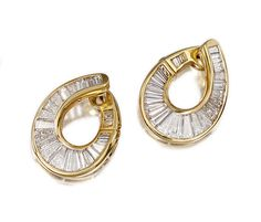 PAIR OF DIAMOND EARRINGS, BULGARI, 1980S.  Each designed as a hoop set with graduated baguette and tapered baguette diamonds, mounted in yellow gold,  signed Bulgari, maker's marks.