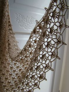 I'd like to crochet this on a large scale in white and hang it over a sheer white curtain around the windows.