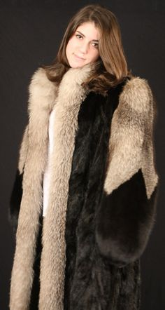 mink & fox fur coat. Nice looking coat on her.