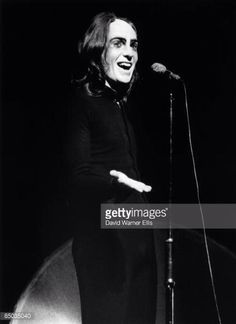 Peter Gabriel onstage with Genesis at the Drury Lane theatre