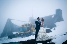 Bride and Groom holding each outher close in the fog and snow outside Silcox Hut with the snow cat that we rode up to get up to the beautiful cabin above Timberline Lodge, Oregon. It was definitely an awesome and unique location for a wedding! http://www.joshuameador.com/weddings/snowwy-silcox-hut