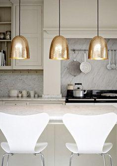 brass pendants, marble backsplash, pegs under cabinets (smart)