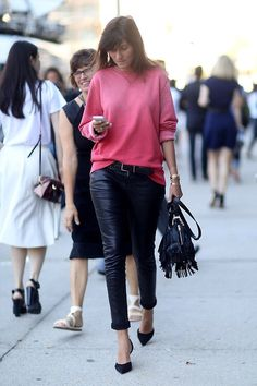 Emanuelle Alt wearing die tye red sweatshirt, leather trousers and fringed bag...