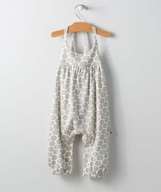 You'll love the bright colors set on a classic light color harem cut romper, because it goes with nearly any basic short or long sleeve top for an all play day outfit that keeps her warm and comfortable. The hand-drawn circular geometric pattern comes fresh from the desk of our Hallmark art design lab.