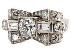 Diamantring Ringweite: 54. Gewicht: ca. 11,8 g. Platin. Um 1940. Feiner, strenger Ring in stilisiert — Schmuck_Juwelen