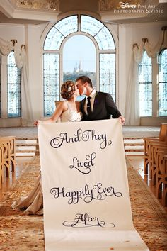 """""""And they lived happily ever after"""" - This Disney couple used their aisle runner for a cute shot in Disney's Wedding Pavilion."""