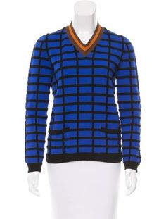 Blue, black and multicolor Marni sweater with V-neck featuring contrast orange and brown pattern, long sleeves, dual seam pockets at front and grid pattern throughout.