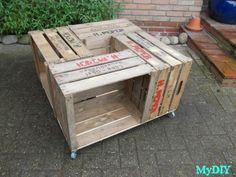 Crate Coffee Table.  Use screws to attach 4 crates to a piece of plywood. Center square can be used to hold a plant, candle, etc.  Dimensions: 76x76 cm.