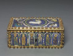 This champlevé enamel casket belongs to a distinct group of nine closely related objects characterized by the vivid colors of their enamel decoration and rows of spherical pins placed along the edges