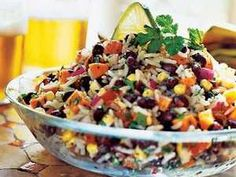 This colorful salad combines black beans, rice, and an assortment of summer vegetables for a cool side fit for entertaining.