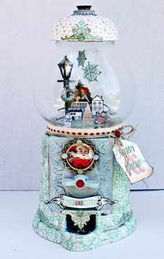 """The new Sweet Peppermint line is so perfect for all of your Christmas projects! And the matching stamp sets with dies?!?! Wow! I just had to create my own version of a snowglobe using the papers and that gorgeous stamp set! The imagery in the stamp set is so adorable, and made a perfect little scene! I used glass glitters and mica flakes for my ""shaker"" snow element. This piece was really fun to do!"" ~ Miranda Edney"