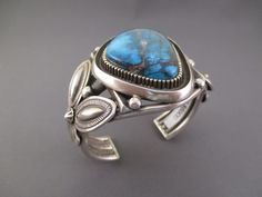 Sterling Silver Cuff Bracelet with an ABSOLUTELY STUNNING Bisbee Turquoise stone. Made by Navajo jewelry artist and silversmith, Terry Martinez.