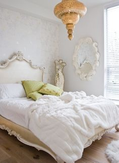 glamourous bedroom + gold and satin accents + fur throw + antique French bed