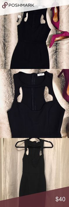"""Tobi Cut out Front Black Mini Dress Sexy Tobi black spandex blend mini dress (very stretchy) size small, measure 33"""" long from top of shoulder to bottom of dress. Very cute opening on front. Zipper on back. Excellent condition, like new. Offers welcome:) Tobi Dresses Mini"""