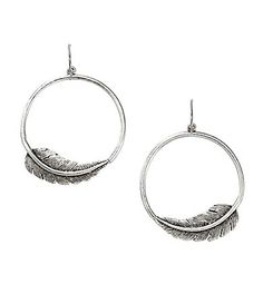 "Add a touch of whimsical sophistication to any style with these earrings from Fossil. The gypsy-style hoops are adorned with vintage silvertone feathers.  vintage silvertone plated base metal  fishhook closure  1.75"" drop"