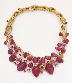 Old carved Mughal rubies set in a French 1950s gold and diamond necklace by…