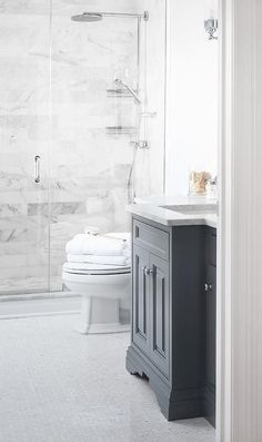 Beautiful bathroom features a dark gray vanity topped with carrera marble atop a white marble herringbone tile floor. Beautiful bathroom features a dark gray vanity topped with carrera marble atop a white marble herringbone tile floor. Bathroom Renos, White Bathroom, Bathroom Flooring, Bathroom Interior, Bathroom Marble, Bathroom Ideas, Master Bathroom, Vanity Bathroom, Marble Wall