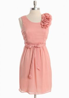Where can I find this Rosettes dress? I love it. Or shall I try make it one myself. What kind fabric, and what pattern shall I purchase, if I want to make it?