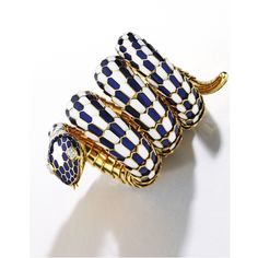 18 Karat Gold, Enamel and Diamond 'Serpenti' Wristwatch, Bulgari, Vacheron Constantin. Designed as a serpent, the scales applied with blue and white enamel, with marquise-shaped diamond eyes.