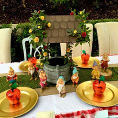 Loving this centerpiece at this Snow White's Woodland Picnic party! The dwarfs are so adorable! See more party ideas at CatchMyParty.com