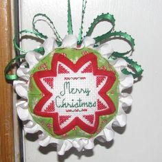 Personalized and customized Christmas ornaments.  Folded fabric with cross-stitch on both sides.