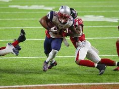 Patriots running back James White (28) fights his way - 2016 New England Patriots Super Bowl Championship