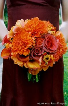 Bridesmaids wore burgundy dresses and carried bouquets in vibrant autumn hues such as terra cotta, rust and orange. Flowers included dahlias, calla lilies and roses. More Beautiful Flowers Like This! Bridal Flowers, Flowers In Hair, Orange Flowers, Pretty Flowers, Floral Wedding, Wedding Colors, Wedding Ideas, Wedding Decor, Wedding Planning