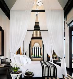 Using a canopy to minimize the enormous height of the ceiling in this bedroom