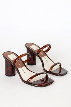 Elevate every outfit with the Dolce Vita Noles Tortoise Vinyl High Heel Sandals! Sleek vinyl forms a squared toe, two-strap silhouette, and a rounded heel. Pretty Shoes, Cute Shoes, Me Too Shoes, 80s Shoes, Clear High Heels, Shoes Sandals, Shoe Boots, Heeled Sandals, Sandal Heels