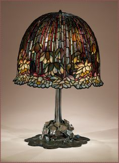 Lamp, Louis Comfort Tiffany (American, Tiffany Studios Leaded Favrile glass, bronzeThis water-lily table lamp is one of Tiffany's most successfully executed designs for his firm's well-known leaded-glass products. Tiffany Stained Glass, Stained Glass Lamps, Tiffany Glass, Tiffany Art, Leaded Glass, Mosaic Glass, Antique Lamps, Vintage Lamps, Vintage Lighting