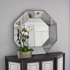 Octo Mirror - An antique mirror frame with reverse carved bulls eye design. Interior clear mirror has 1'' bevel. Exterior fame is made of solid wood with a faux metal finish. #ambella #mirror