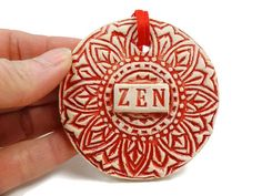 Listing is for one ceramic Zen ornament. I hand sculpt, stamp and glaze every ornament individually. Each is one of a kind.  Measures