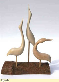 Surplus pieces of wood have been used to carve these elegant Egrets