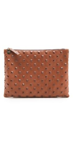 Studded flat clutch by Clare Vivier.