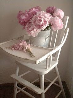 pretty pink flowers on a vintage high chair. . . Cabin & Cottage