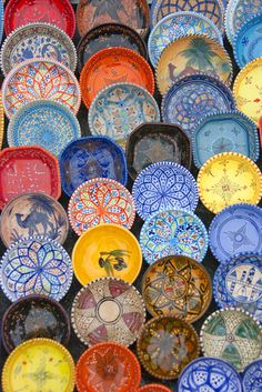 The colorful pottery of Tunisia   oh, i'd love all of these plates hanging in my house